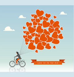 man on a bike with hot air balloons in the sky vector image