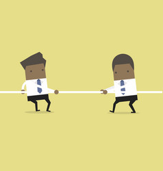 African businessman playing tug of war vector