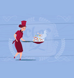 Female chef cook holding frying pan cartoon vector