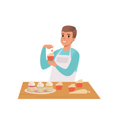 smiling man cooking cupcakes young man in casual vector image