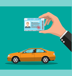 Driver license in hand and orange sedan car vector