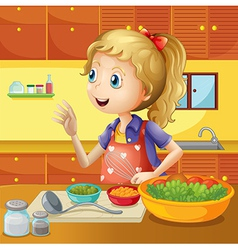 A young chef in the kitchen vector