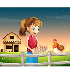 A woman holding an eggtray with eggs near the vector image