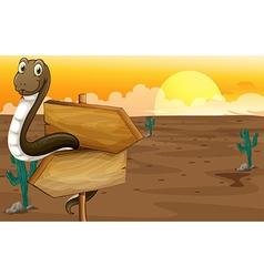 Snake in the desert near the signboard vector image vector image