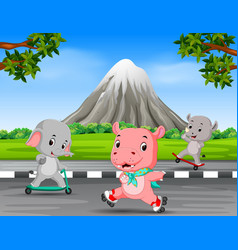 Three animals playing in the road vector