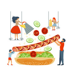 Happy family cooking together a hot dog vector