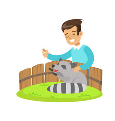 smiling little boy petting and feeding a raccoon vector image vector image