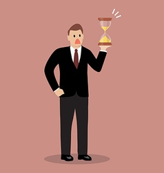 Businessman holding sandglass vector