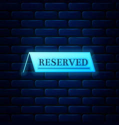 Glowing neon reserved icon isolated on brick wall vector
