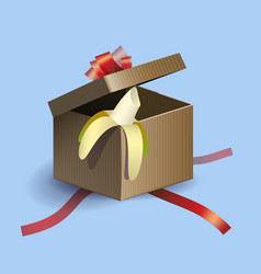 Opened gift box with red strips and banana inside vector