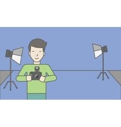Photographer in studio vector