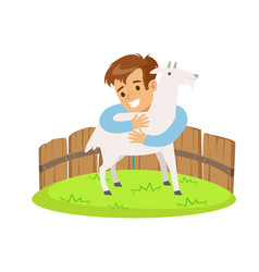 happy little boy embracing a white goat in a mini vector image vector image