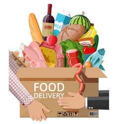 cardboard box with fresh products in hand vector image