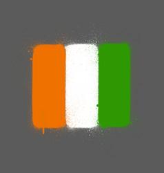 Graffti ivory coast flag sprayed over grey vector