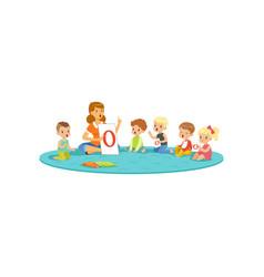 group of little kids sitting on carpet vector image