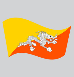 flag of bhutan waving on gray background vector image vector image