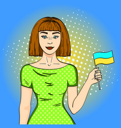 Pop art happy young girl with the ukrainian flag vector