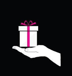 gift box in hand on black vector image vector image