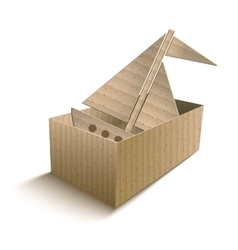 Toy boat in an open cardboard box vector image vector image
