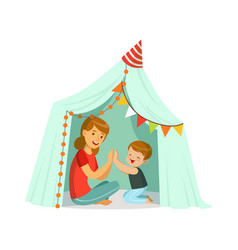 Mum and her son playing in a tepee tent kid vector