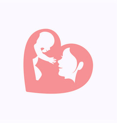 mother raising a baby in heart shaped silhouette vector image