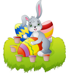 cartoon easter bunny painting an egg vector image