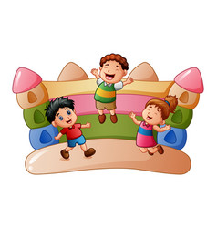 cartoon kids playing at the bouncing house vector image