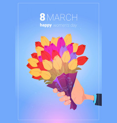 Hand hold bouquet of tulips happy women day vector