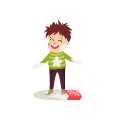 Happy misbehaving boy playing with flour cartoon vector