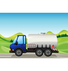 An oil tanker near the hills vector image