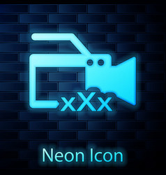 Glowing neon video camera with inscription xxx vector