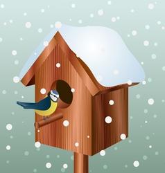 Winter bird house with little bird vector
