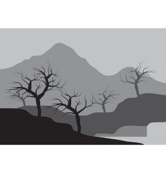 Silhouettes of dry tree on the mountain vector
