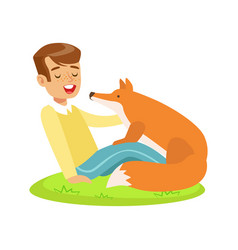 smiling boy sitting on green grass and petting red vector image