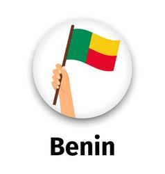 benin flag in hand round icon vector image