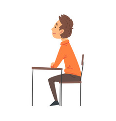 Boy student sitting at desk in classroom and vector