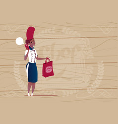 female african american chef cook holding bag with vector image
