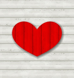 Red heart on wooden background for Valentine Day vector image