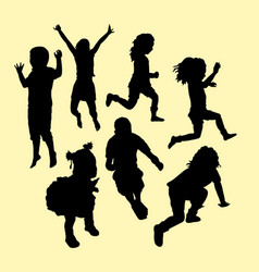 happy kid running and jumping silhouette vector image