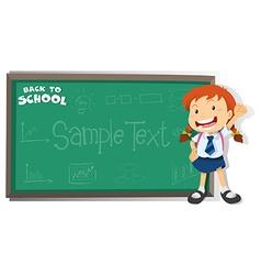 Little girl standing by the blackboard vector image