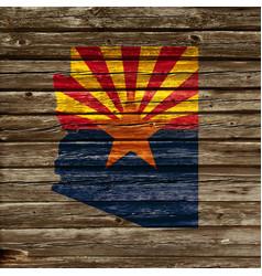 Arizona map flag on old timber wall vector