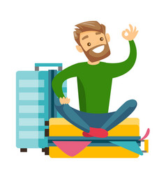 Young caucasian white man sitting on suitcase vector