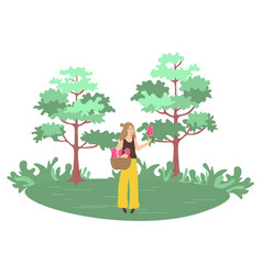 woman picking flowers forest with trees vector image