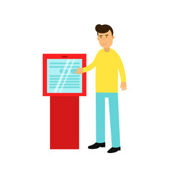 Young man buying cinema tickets in touchscreen vector