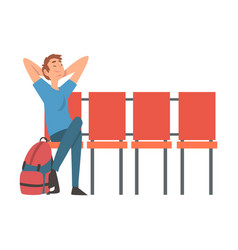 young man with backpack waiting at airport vector image