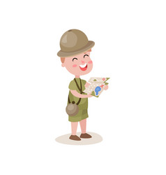 excited little boy scout holding map in hands vector image