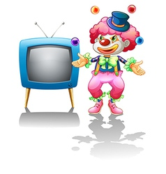 A clown standing near the TV vector image vector image