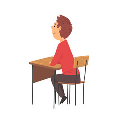 Boy student sitting at desk in classroom side vector
