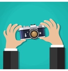 Flat of photo camera with hand vector image