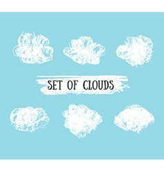 Collection of hand drawn grunge clouds on the blue vector
